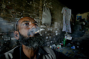 "Hooked into the sewers from Peshawar.<br /> <br /> Photographer Ton Koene took a week on heroin addicts in the sewers of Peshawar, a desolate town in Northern Pakistan. In the cracks of the world, between rats and cockroaches and under bridges and on garbage dumps, he met people, sometimes children, who have lost almost all hope.<br /> <br /> ""Give me one good reason why I should quit. I have no future, no job and income, and will never get it again. I spray me to the grave. ""So says the 11-year-old Salim Mula. Eleven years pass, petite and small, but speaking as a grown man.<br /> <br /> Salim is one of the more than 10,000 drug addicts in Peshawar, a poor northern Pakistani town with a population similar to Rotterdam. The main reason for the relatively high number of addicts in Peshawar is a lack of perspective to a job or income is hard to come by in this corner of the world. Often suffers depression to smoking hashish and the step to heroin is easily made. On every street corner to get it. As a little test I ask a young rascal to a few grams of heroin and look at my watch how long it takes. Within 40 seconds, the guy in front of me with the loot.<br /> <br /> Living in the sewers<br /> In one of the many sewers of Peshawar, I met a group of about twenty addicts. Dr. Noman a local Pakistani aid agency introduces me. The addicts greet us with a drunk alekum salam 'and stare at us with half-closed eyes. They should make every effort to focus on the visit, but also to their use: they uncoordinated stabbing a match to heat their heroin. A few meters away from them, along the asphalt, lie the graves. Luguber to see is that a hole has already been dug for the next victim. The addicts are literally using their own grave.<br /> <br /> Most addicts smoke fumes of heroin powder that they liquefy tinfoil on a piece of paper by heating it with a match. With a straw they inhale the anesthetic vapors. 'Chasing the dragon' is called in jargon users, because the liquid heroin moisture away from the tinfoil runs down. ""They will be but little i"