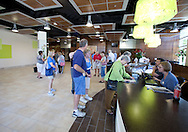 People lineup to purchase tickets in the main lobby at the open house for the Coralville Center for the Performing Arts in Coralville on Saturday, August 27, 2011.