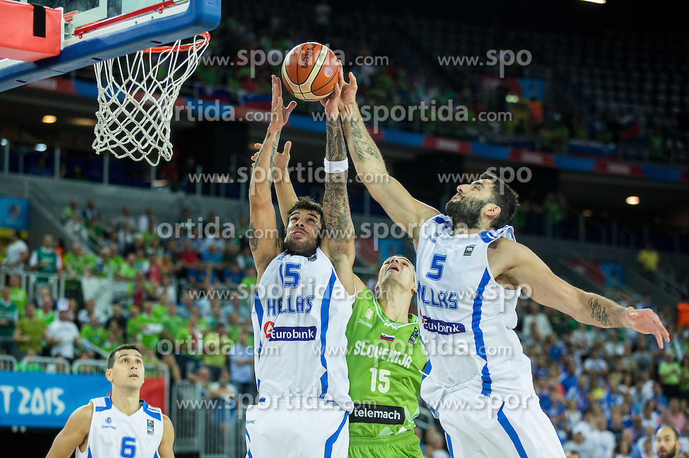 Jure Balazic of Slovenia between Georgios Printezis of Greece and Yannis Bourousis of Greece during basketball match between Slovenia vs Greece at Day 5 in Group C of FIBA Europe Eurobasket 2015, on September 9, 2015, in Arena Zagreb, Croatia. Photo by Vid Ponikvar / Sportida