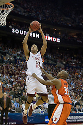 Virginia Tech Hokies forward Coleman Collins (33) shoots over Illinois Fighting Illini guard Rich McBride (33).  The #5 seed Virginia Tech Hokies defeated the #12 seed Illinois Illini 54-52 in the first round of the Men's NCAA Tournament in Columbus, OH on March 16, 2007.