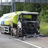 The remains of a BP pertrol tanker which caught fire on the M90 near the Friarton Bridge in Perth early this morning which closed the motorway for a number of hours...A lucky escap for the driver as the tanker was fully loaded with fuel....23.07.15<br /> Picture by Graeme Hart.<br /> Copyright Perthshire Picture Agency<br /> Tel: 01738 623350  Mobile: 07990 594431