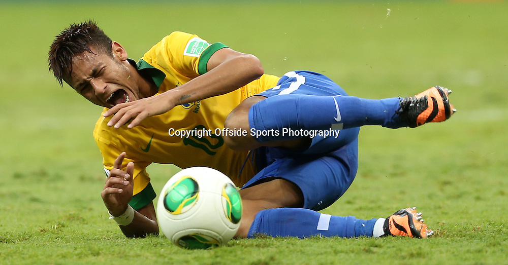 15th June 2013 - FIFA Confederations Cup 2013 - Brazil v Japan - Neymar of Brazil goes down after a challenge - Photo: Simon Stacpoole / Offside.