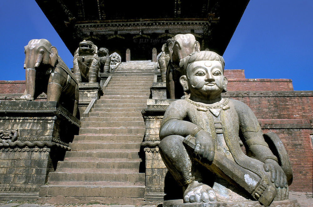 Bhaktapur, Nyatapola temple, steps & statuary, built 1708.  Looking up the stairs; statue of Shiva in the foreground, at the bottom of the stairway.