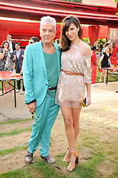 NICKY HASLAM and CAROLINE SIEBER at the annual Serpentine Gallery Summer party this year sponsored by Jaguar held at the Serpentine Gallery, Kensington Gardens, London on 8th July 2010.  2010 marks the 40th anniversary of the Serpentine Gallery and the 10th Pavilion.