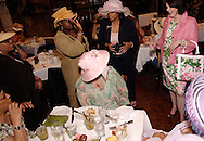 Julie White of Beavercreek (right) models some clothes from Talbott's during the Derby Day Brunch, benefiting the Kettering Wellness Center, held at the Brio Tuscan Grille in the Greene, Saturday, May 1, 2010.