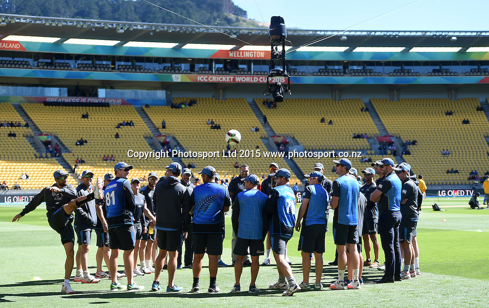 Grant Elliott kicks a soccer ball as spider cam during a team meeting at the ICC Cricket World Cup quarter final match between New Zealand Black Caps and the West Indies, Wellington, New Zealand. Saturday 21March 2015. Copyright Photo: Andrew Cornaga / www.Photosport.co.nz