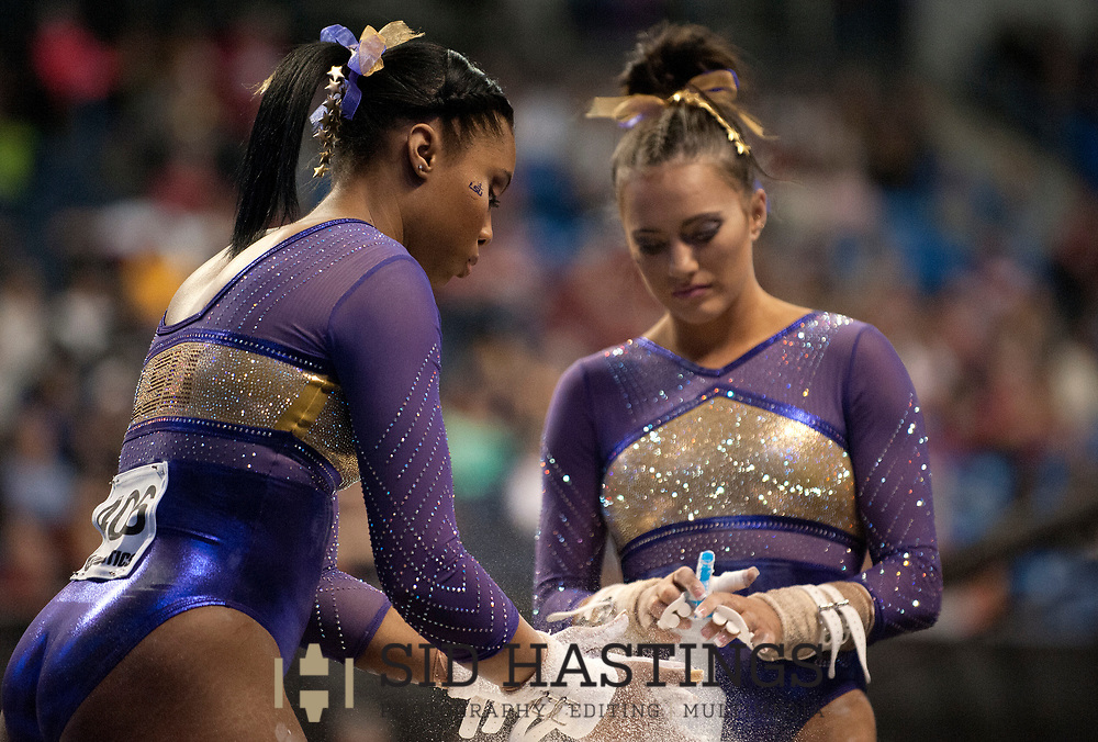 20 APRIL 2018 -- ST. LOUIS -- LSU gymnasts Kennedi Edney (left) and Lexie Priessman prepare for the Uneven Parallel Bars during the 2018 NCAA Women's Gymnastics Championship Semifinals in St. Louis Friday, April 20, 2018. LSU finished second in the semifinal, joining UCLA and Nebraska in advancing from the first semifinal into the Super Six championship round on Saturday.<br /> <br /> Photo &copy; copyright 2018 Sid Hastings.