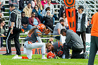 KELOWNA, BC - OCTOBER 6: Athletic therapist Roy Gillespie tends to Dawson Puk #49 as Nate Adams #41 of Okanagan Sun kneels on the field against the VI Raiders at the Apple Bowl on October 6, 2019 in Kelowna, Canada. (Photo by Marissa Baecker/Shoot the Breeze)