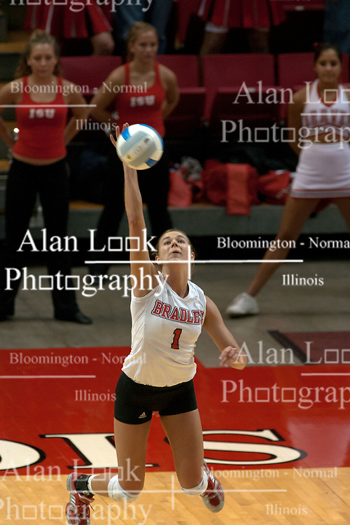 09 OCT 2005 Brave's no 7 nationally ranked power hitter, Lindsay Stalzer, applies some heat to a serve. The Illinois State University Redbirds hosted arch rival Bradley University Braves.  The Redbirds soared over the Braves, taking the match in 4 games, losing only game number 2.  Action included play by Braves Star Lindsey Stalzer who is ranked no. 7 in the nation in kills per game.  The first defeat of the conference season for the Braves took place at Redbird Arena on Illinois State's campus in Normal IL.