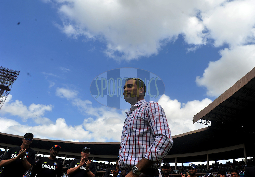 VVS Laxman walks to receive the award at the feliciation ceremony during day three of the second test match between India and New Zealand held at the M. Chinnaswamy Stadium, Bengaluru on the 2nd September 2012..Photo by Pal Pillai/BCCI/SPORTZPICS