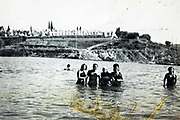 group standing in the water summer vacationing 1940s 1950s