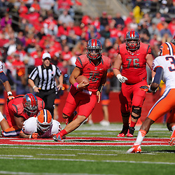 Oct 13, 2012: Rutgers Scarlet Knights quarterback Gary Nova (15) scrambles for a first down during NCAA Big East college football action between the Rutgers Scarlet Knights and Syracuse Orange at High Point Solutions Stadium in Piscataway, N.J.