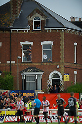 EXETER, ENGLAND - Wednesday, August 24, 2011: Local residents get a free view as Exeter City take on Liverpool during the Football League Cup 2nd Round match at St James Park. (Pic by David Rawcliffe/Propaganda)