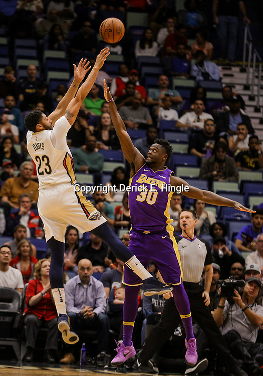 Mar 22, 2018; New Orleans, LA, USA; New Orleans Pelicans forward Anthony Davis (23) shoots over Los Angeles Lakers forward Julius Randle (30) during the first quarter at the Smoothie King Center. Mandatory Credit: Derick E. Hingle-USA TODAY Sports
