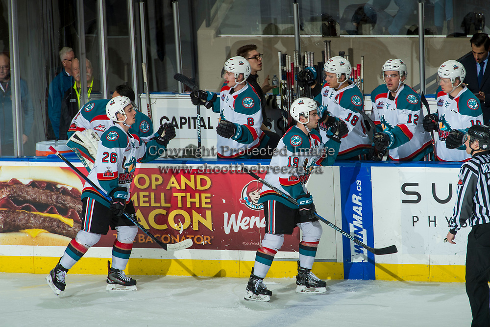 KELOWNA, CANADA - FEBRUARY 20: Dillon Dube #19 and Liam Kindree #26 of the Kelowna Rockets fist bump the bench to celebrate a goal against the Prince George Cougars  on February 20, 2018 at Prospera Place in Kelowna, British Columbia, Canada.  (Photo by Marissa Baecker/Shoot the Breeze)  *** Local Caption ***