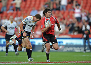 Springbok Centre of the Lions, Jaque Fourie on his way to score the first try for the Lions in the Super 14 match between the Lions and the Brumbies that took place on Saturday 21 March 2009 at Coca-Cola Park in Johannesburg South Africa. The Lions won this Super 14 match against the Brumbies 25 - 17.  <br /> Photographer : Anton de Villiers / SASPA