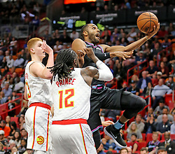 November 27, 2018 - Miami, FL, USA - Miami Heat's Wayne Ellington leaps for a basket past Atlanta Hawks' Taurean Prince (12) in the second quarter on Tuesday, Nov. 27, 2018 at the AmericanAirlines Arena in Miami, Fla. (Credit Image: © Charles Trainor Jr/Miami Herald/TNS via ZUMA Wire)