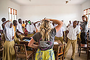 A mid class energiser of the tummy rubbing and head patting organised by ICS volunteer Jamie Steers with students at Mingoyo school. Part of the VSO / ICS Elimu Fursa project (Opportunities in Education) Lindi, Lindi region. Tanzania.