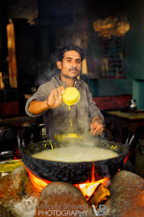 a boy preparing the famous malpua from pushkar, Ajmer, India