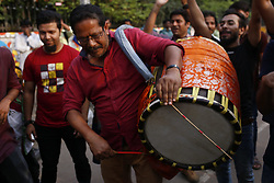April 13, 2018 - Dhaka, Bangladesh - A teature toots a Dhol (traditional instrument) hand as he participates in a colorful parade to celebrate the first day of the Bengali New year known as Pohela Boishakh in Dhaka. (Credit Image: © Md.Mehedi Hasan/Pacific Press via ZUMA Wire)