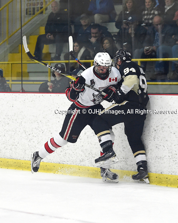 GEORGETOWN, ON - APR 18,  2017: Ontario Junior Hockey League, Championship Series. Georgetown Raiders vs the Trenton Golden Hawks in Game 3 of the Buckland Cup Final.  Matt McJannet #12 of the Georgetown Raiders makes the hit on Cal Walker #94 of the Trenton Golden Hawks during the second period.<br /> (Photo by Andy Corneau / OJHL Images)