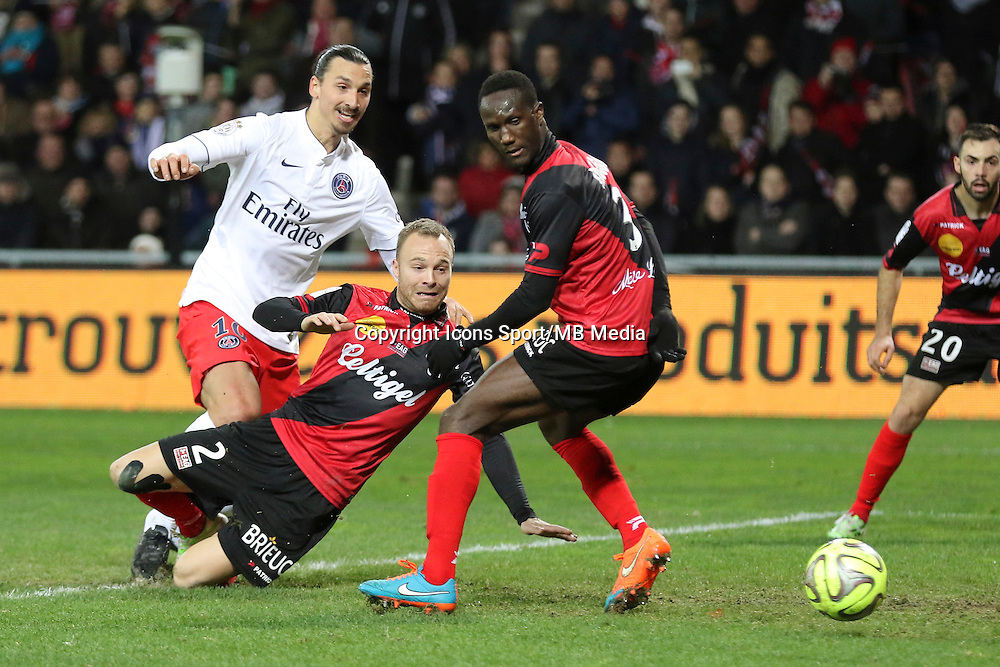 Zlatan IBRAHIMOVIC  / Lars JACOBSEN / Benjamin BROU ANGOUA - 14.12.2014 - Guingamp / Paris Saint Germain - 18eme journee de Ligue 1<br />