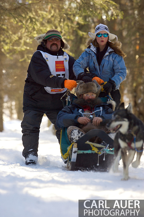 March 7th, 2009:  Anchorage, Alaska: Tim Osmar of Ninilchik, Alaska moves through the woods near Behm Lake during the 2009 Ceremonial Start of the Iditarod.