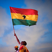 A Ghana supporter waves a Ghanaian flag at a free broadcast of the Ghana vs USA FIFA World Cup match at Independence Square in Accra Ghana on 26 June 2010.