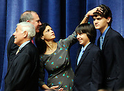 Diana Sousa, center, wife of Connecticut Attorney General-elect George Jepson, left, fixes the hair of their sons Christian and William prior to Jepson taking the stage to be sworn-in to office during the inauguration ceremony for Gov. Dannel P. Malloy as Governor of the state of Connecticut Wednesday, January 5, 2010 at the William A. O'Neill Armory in Hartford.  (Sean D. Elliot/The Day)