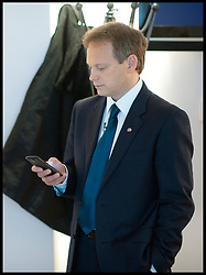 Co-Chairman of the Conservative Party Grant Shapps checks his mobile phone before  his speech at the Conservative Party Conference in Birmingham, Sunday October 7, 2012, Photo by Andrew Parsons / i-Images
