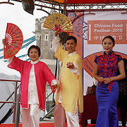 London,England,UK, 19th Aug 2016 : Regardless bad wet weather attendees standing in the rain some with umbrella hungry for Chinese food at the 2016 Chinese Food Festival at Potters Fields Park,London,UK. Photo by See Li