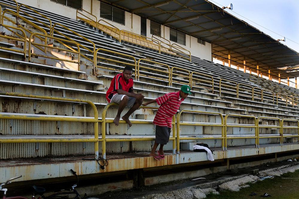 Children play soccer at the Marion Jones Stadium in Belize City, Belize