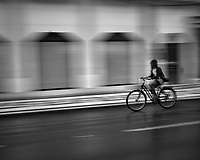 Bicycle in the Rain. Afternoon walkabout in Lisbon. Image taken with a Leica CL camera and 23 mm f/2 lens.