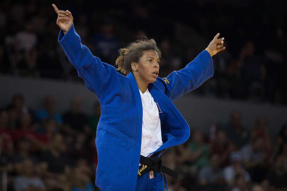 Rafaela Silva of Brazil celebrates her bronze medal win over Anriquelis Barrios of Venezuela in the women's judo 57kg class at the 2015 Pan American Games in Toronto, Canada, July 12,  2015.  AFP PHOTO/GEOFF ROBINS