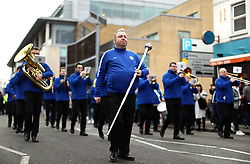 A Chelsea marching band outside the ground before the match begins