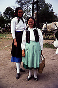 Full length portrait of two women wearing traditional clothes in rural countryside area, Romania, eastern Europe 1967
