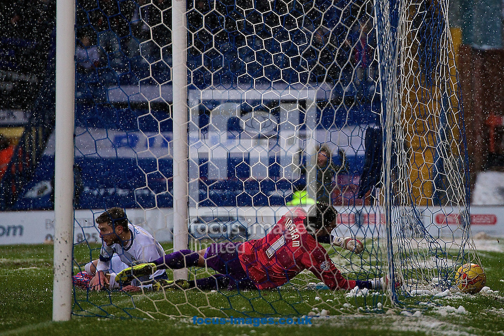 Danny Mayor of Bury (left) scores their first goal to make it Bury 1 Wycombe Wanderers 0 during the Sky Bet League 2 match at Gigg Lane, Bury<br /> Picture by Ian Wadkins/Focus Images Ltd +44 7877 568959<br /> 17/01/2015