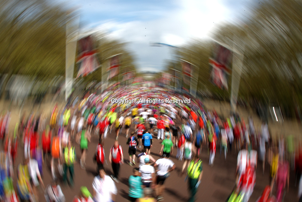22.04.2012 London, England. A blurred view of the Runners at the finishing line of the 2012 Virgin London Marathon on The Mall in front of Buckingham Palace