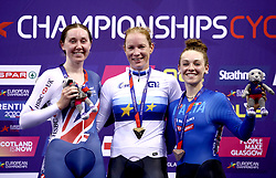Netherland's Kirsten Wild (centre) celebrates winning gold alongside Great Britain's Katie Archibald (left) with silver and Italy's Letizia Paternoster with Bronze in the Omnium IV Women 20KM Points Race during day five of the 2018 European Championships at the Sir Chris Hoy Velodrome, Glasgow.