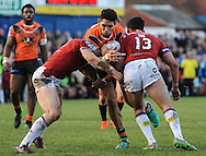 Mitch Allgood (L) & Mikey Sio (R) of Wakefield Trinity Wildcats tackles Jesse Sene-Lefao of Castleford Tigers during the Pre-season Friendly match at Belle Vue, Wakefield<br /> Picture by Richard Land/Focus Images Ltd +44 7713 507003<br /> 15/01/2017