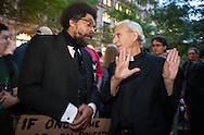 New York City, NY, Sept 27th 2011, Cornel West , philosopher, author, critic, intellectual, civil rights activist and Professor at Princeton University speaks to Father Paul Mayer, an activist minister at  the Occupy Wall Street protest in Zuccotti Park  ( also know as Liberty Square)  .  The protesters set up and encampment in Liberty Square inspired by the Egyptian Tahrir Square uprising<br /> on Sept. 17th 2011 .