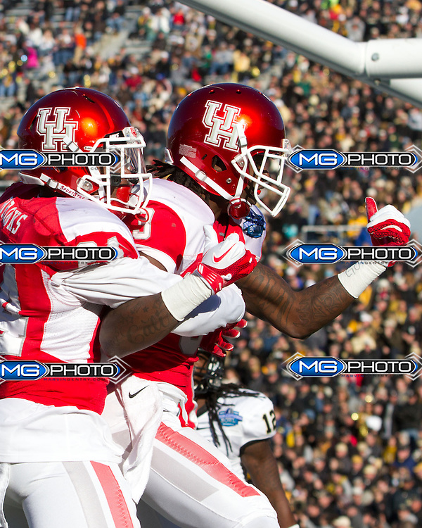 Jan 4, 2014; Birmingham, AL, USA; Houston Cougars wide receiver Deontay Greenberry (3) reacts after his team scored against the Vanderbilt Commodores during the 2014 Compass Bowl at Legion Field. The Commodores defeated the Cougars 41-24. Mandatory Credit: Marvin Gentry-