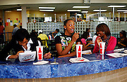 """From left, Jasmine Pendergraph, a freshman accounting major, joins friends Ke'Aira Davis, a freshman mass communications major and Me'Kia Davis, a freshman accounting major for lunch at the King-Frazier Student Center's dining hall at Savannah State University, an historically black university in Savannah, Georgia February 9, 2009. Me'Kia Davis said the history of her school is important to her. """"It's HBCU... There's a lot of historic background at this school,"""" she said. KENDRICK BRINSON"""