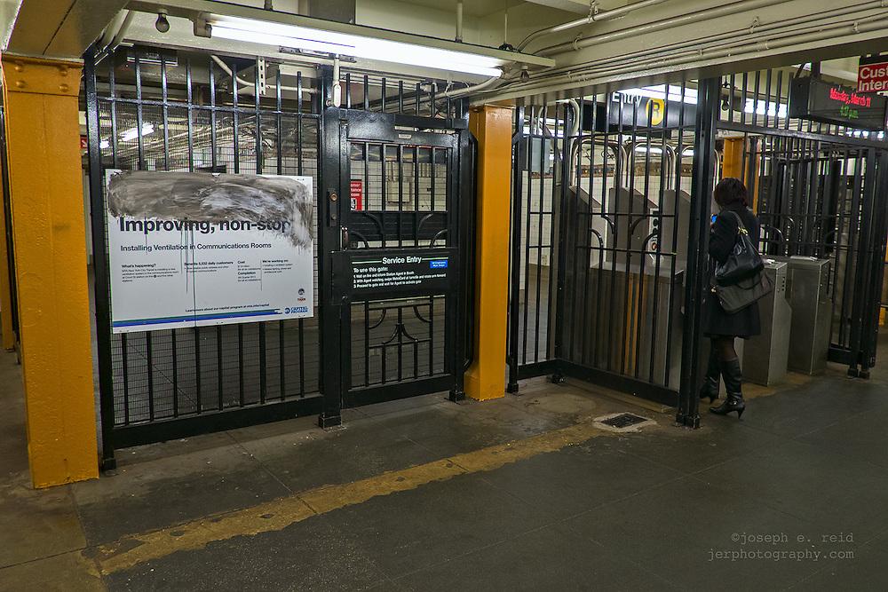 """Sign at subway entrance: """"Improving, non-stop"""""""