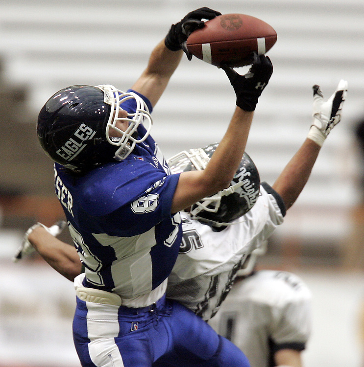 Dobbs Ferry wide receiver Frank Reiser, 82, makes a nice catch on this play as Dobbs Ferry faced Bishop Ludden in the Class C Section 1 State Final football tournament at the Carrier Dome in Syracuse Nov. 25, 2007.  Final score was Bishop Ludden 21, Dobbs Ferry 16.  ( Mike Roy / The Journal News )