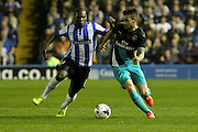Sheffield Wednesday midfielder Jeremy Helan and Arsenal defender Mathieu Debuchy challenge for the ball during the Capital One Cup Fourth Round match between Sheffield Wednesday and Arsenal at Hillsborough, Sheffield, England on 27 October 2015. Photo by Aaron Lupton.