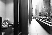 Office worker in his office on street level NYC