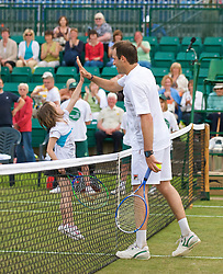 NOTTINGHAM, ENGLAND - Friday, June 12, 2009: A youngster plays with Greg Rusedski (GBR) on day two of the Tradition Nottingham Masters tennis event at the Nottingham Tennis Centre. (Pic by David Rawcliffe/Propaganda)