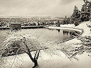 Fresh snow blankets Reservoir 5, one of three open reservoirs at Mt Tabor Park and of five total in Portland (background).  The 3 open reservoirs in Mount Tabor Park were placed in the National Register of Historic Places on January 15, 2004.  Environmental Protection Agency (EPA) regulation: Long Term 2 Enhanced Surface Water Treatment Rule, referred to as the LT2 rule imposes new requirements that open water reservoirs be covered, buried or additionally treated.  This applies to Portland's five open reservoirs and to the unfiltered Bull Run sourse supplying them.  Photo: January 2002.  Nikon F4, 24-85/2.8-4D.  Kodak E100VS
