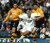 Photo. Andrew Unwin<br /> Leeds United v Blackburn Rovers, Barclaycard Premier league, Elland Road, Leeds 04/10/2003.<br /> Leeds' Alan Smith (c) squeezes between Blackburn's Garry Flitcroft (l) and Nils-Eric Johansson (r).